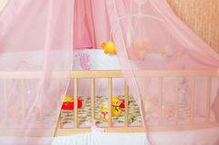 Cots with different soft toys Royalty Free Stock Images
