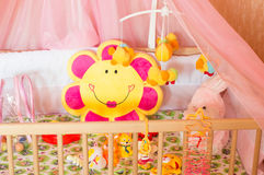 Cots with different soft toys Royalty Free Stock Image