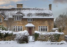 Cotswold cottage in snow royalty free stock photo