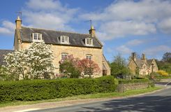 Cotswold farmhouse. With pretty garden, Gloucestershire, England Stock Images
