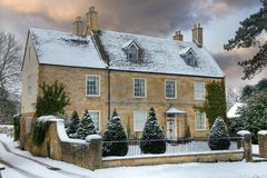 Cotswold home with snow Stock Photos