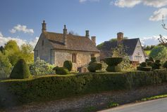 Cotswold House with topiary hedge Royalty Free Stock Photography