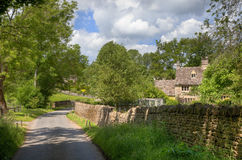 Cotswold lane with cottage Royalty Free Stock Image
