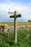 Cotswold Sign, The Cotswolds, England. A sign providing direction along a walk in the beautiful countryside of The Cotwolds, England Royalty Free Stock Image