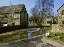 Scenic Cotswolds - Duntisbourne Leer. Cotswold stone cottages by the old ford in spring sunshine,  Duntisbourne Leer, Cotswolds, Gloucestershire, UK Stock Photo