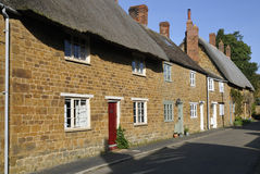 Cotswold Stone Thatched Cottages Royalty Free Stock Photo