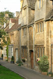 Cotswold terrace. Typical cotswold architecture with honey coloured block limestone terrace buildings Royalty Free Stock Image