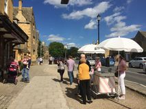 A Cotswold town view in the summer. Broadway high street in blue sky Stock Photography