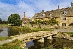 Cotswold village of Lower Slaughter, Gloucestershire, England. Stream running through the picturesque Cotswold village of Lower Slaughter, Gloucestershire Stock Image