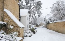 Cotswold village in Snow, Gloucestershire, England Stock Photo