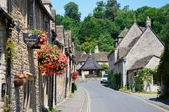 Cotswold village street, Castle Combe. Stock Photos