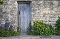 Cotswold wall with wooden door Stock Photos
