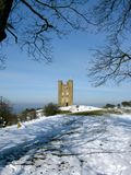 Cotswolds England Broadway Tower winter snow. Broadway Tower in the English Cotswolds in a snow-covered field Royalty Free Stock Images