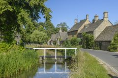 Cotswolds Hills - village made with Cotswold stone-UK. Image was taken on 2018 August, in the magic place for me -Cotswolds Hills region of England. Beatiful old stock photography