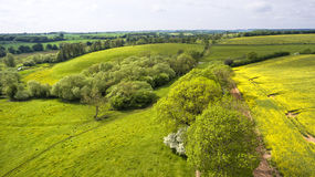 Cotswolds rolling hills of fields and meadows in spring Stock Images