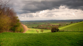 Cotswolds rolling hills. View near the Warwickshire village of Ilmington, Cotswolds, England Royalty Free Stock Images