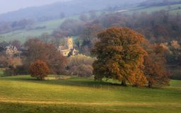 Cotswolds St. Eadburgha`s Church in Autumn stock photography