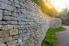 Free Cotswolds Stone Fence Shown In Leading Perspective With Sun Flare Stock Images - 91526994
