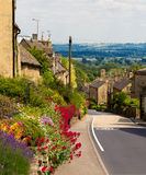 Cotswolds village Bourton-on-the-Hill, UK. Cotswolds village Bourton-on-the-Hill with flowers, UK Stock Images