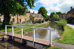 Cotswolds village of Lower Slaughter. Idyllic Cotswolds village of Lower Slaughter in early summer sunshine Royalty Free Stock Photo