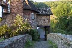 Cottage. Old bridge leading to an old english cottage Royalty Free Stock Images