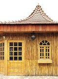 Cottage. Front view of an small wooden cottage Stock Image