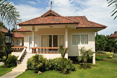 Cottage. New cottage in tropical garden Royalty Free Stock Images