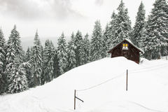 Cottage. In winter and dark clouds Royalty Free Stock Photo