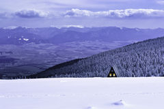 Cottage. In winter and dark clouds Stock Photo