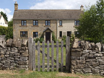 Cottage. A cottage with a gate and door Royalty Free Stock Photo