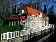 Cottage. Tiny beautiful cottage standing near the canal Royalty Free Stock Image