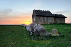 Cottage. Old stone cottage at sunset Royalty Free Stock Images