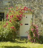 Cottage. With roses around door Royalty Free Stock Photo
