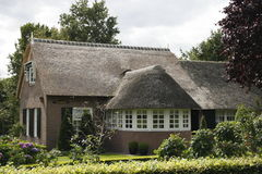 Cottage. Beautiful picturesque cottage with thatched roof Royalty Free Stock Images