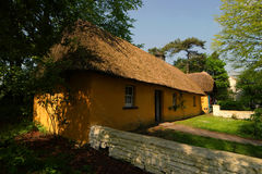 Cottage. Farmers cottage,with thatched roof,used as dwelling house in Ireland especially up to and including 1950, on show in Bunratty Folk Park Royalty Free Stock Photography