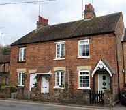 Cottage ai numeri fondo di 3 e di 1 Chorleywood, Chorleywood fotografia stock