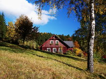 A cottage in autumn. A cottage in Jindrichov in autumn, Jizerske hory Royalty Free Stock Photography