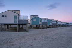 Cottage on the beach. Meeting new day at the North Sea Royalty Free Stock Image