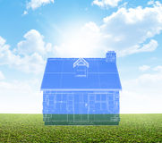 Cottage Blueprint On Green Lawn Stock Photo