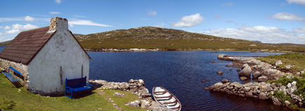 Cottage and boat in Connemara Stock Photography