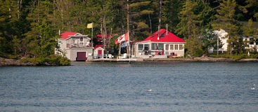 Cottage with a boathouse Royalty Free Stock Images