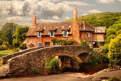 Cottage by the Bridge. This attractive cottage by a packhorse bridge is in Allerford, Somerset, England Royalty Free Stock Photos