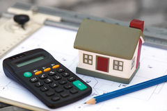 The cottage and calculator Stock Photography