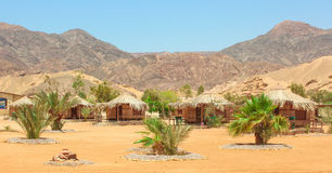 Cottage in a Camp in Sinai. Taba desert with the Background of the Sea and Mountains stock image