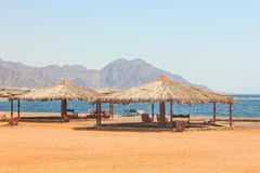 Cottage in a Camp in Sinai. Taba desert with the Background of the Sea and Mountains Royalty Free Stock Photo