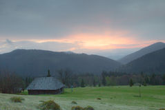 Cottage in the Carpathians. Mountains, sunrise, spring 2014 Royalty Free Stock Photography