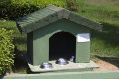 House for cats with bowls for feed on a green lawn royalty free stock photos