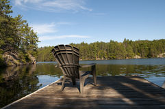 Cottage Chair on the Dock Royalty Free Stock Photos