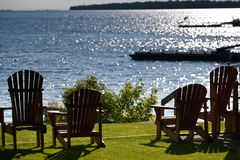 Cottage chairs facing the lake Royalty Free Stock Images