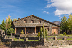 Cottage, chalet. Front view of a house in Guadalajara, with Mount Ocejón the background. Spain Royalty Free Stock Images